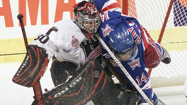 The Quebec Remparts battled but didn't have enough to compete as hosts in 2003, giving way to the juggernaut Kitchener Rangers. (CP/Jacques Boissinot)