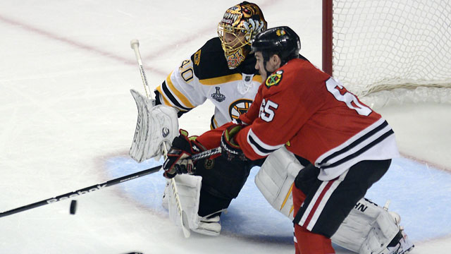 Andrew Shaw gave the Chicago Blackhawks a toehold in their Stanley Cup final against the Boston Bruins, taking Game 1 in 2013 at 12:08 of the 3rd overtime. (AP/John Starks)
