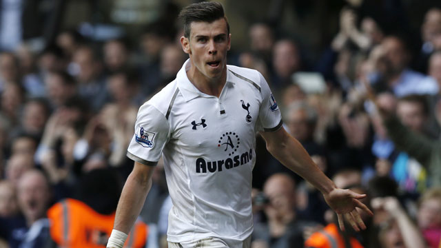 The biggest question surrounding Tottenham Hotspurs' superstar Gareth Bale this off-season was not how good he is, but rather how much that remarkable, world class talent is worth. Since Real Madrid began expressing serious interest in the Welsh international midfielder this past May, numbers between £85 million and £105 million have been thrown around concerning his transfer fee, with the most recent news being disagreement on which end of that gaudy spectrum he belongs. Nevertheless, the north London club has maintained his services for the time being and there is little doubt that in terms of speed, intensity, strength and power in a winger, it is near impossible to find someone better in the Premier League (and maybe even the world). At only 24 years of age, the scary part about him is that he can still get better, and while it seems likely that one of the world's giants will pick him up eventually, he will certainly fetch a steep price for his services. (AP/Sang Tan)