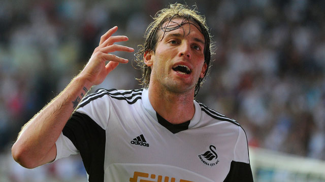There were few bigger on-pitch stories from last year's season than the emergence of Swansea City's striker Michu as an elite scoring force in the Premier League. Responsible for about 40% of the Welsh club's goals in 2012-13, the 27-year-old Spaniard arrived from Rayo Vallecano for a fee of only £2 million and helped lead them to a Europa League appearance as a result of a League Cup championship over cindarella Bradford City in February, 2013. His performances earned him a new four-year deal earlier this year and a chance at cracking the Spanish national team appears almost within his reach. Equally adept at playing striker and attacking midfield, Michu is superb at holding up the ball in narrow formations and is extremely difficult to contain in the air. (AP/Andy Lloyd)