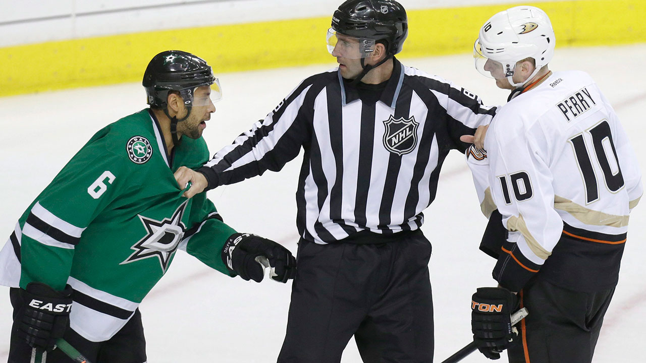 Linesman-Steve-Miller,-center,-keeps-Dallas-Stars-defenseman-Trevor-Daley-(6)-and-Anaheim-Ducks-right-wing-Corey-Perry-(10)-apart-during-the-second-period-of-Game-6-of-a-first-round-NHL-hockey-playoff-series-in-Dallas,-Sunday,-April-27,-2014.-(LM-Otero/AP)