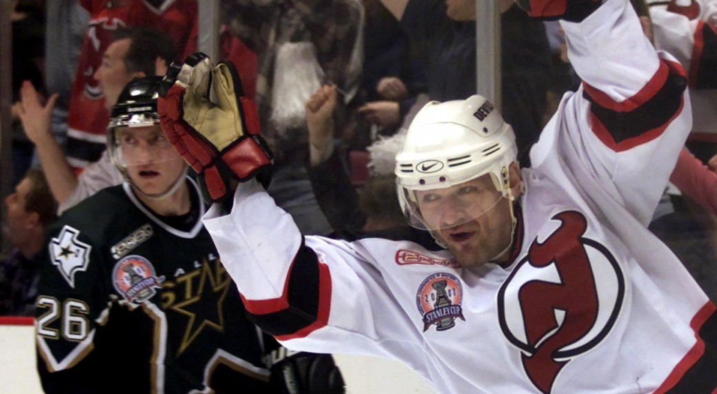 New-Jersey-Devils-right-winger-Claude-Lemieux-(right)-celebrates-during-second-period-NHL-Stanley-Cup-game-1-action-in-East-Rutherford,-N.J.,-on-Tuesday-May-30,-2000.-(Frank-Gunn/CP)