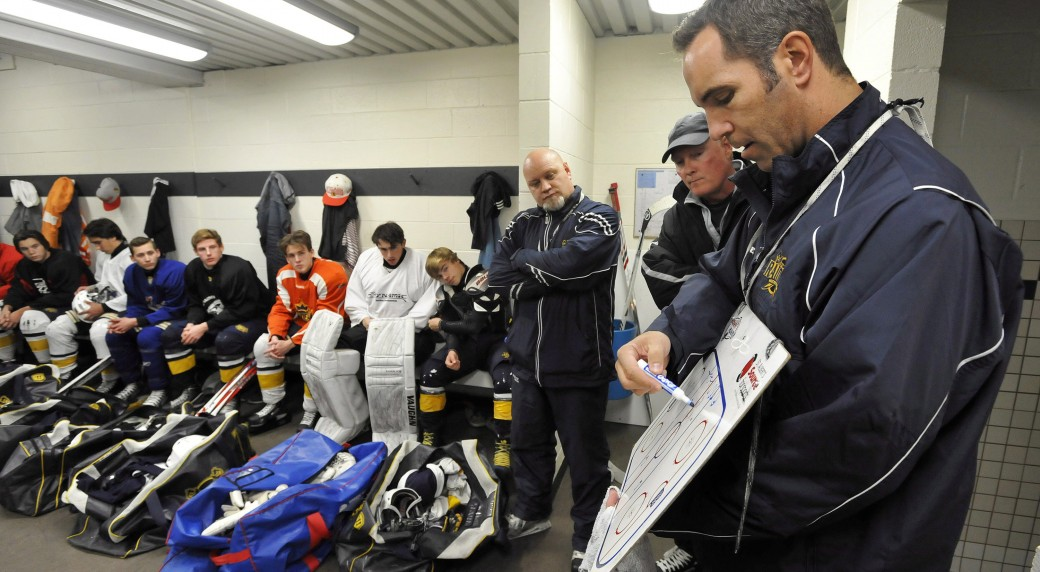 Former-NHL-player-Chris-Joseph-(right),-co-coach-of-the-St.-Albert-Midget-AA-Blues,-outlines-a-drill-prior-to-practice-in-St.-Albert,-Alta.,-Tuesday,-Sept.-23,-2014.-(Dan-Riedlhuber/CP)