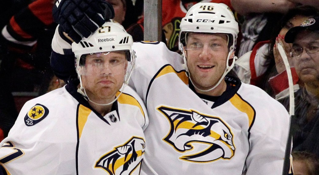 Nashville-Predators'-Andrei-Kostitsyn-(46)-celebrates-with-Patric-Hornqvist-(27)-after-scoring-his-goal-during-the-first-period-of-an-NHL-hockey-game-against-the-Chicago-Blackhawks-in-Chicago,-Sunday,-March-25,-2012.-(Nam-Y.-Huh/AP)