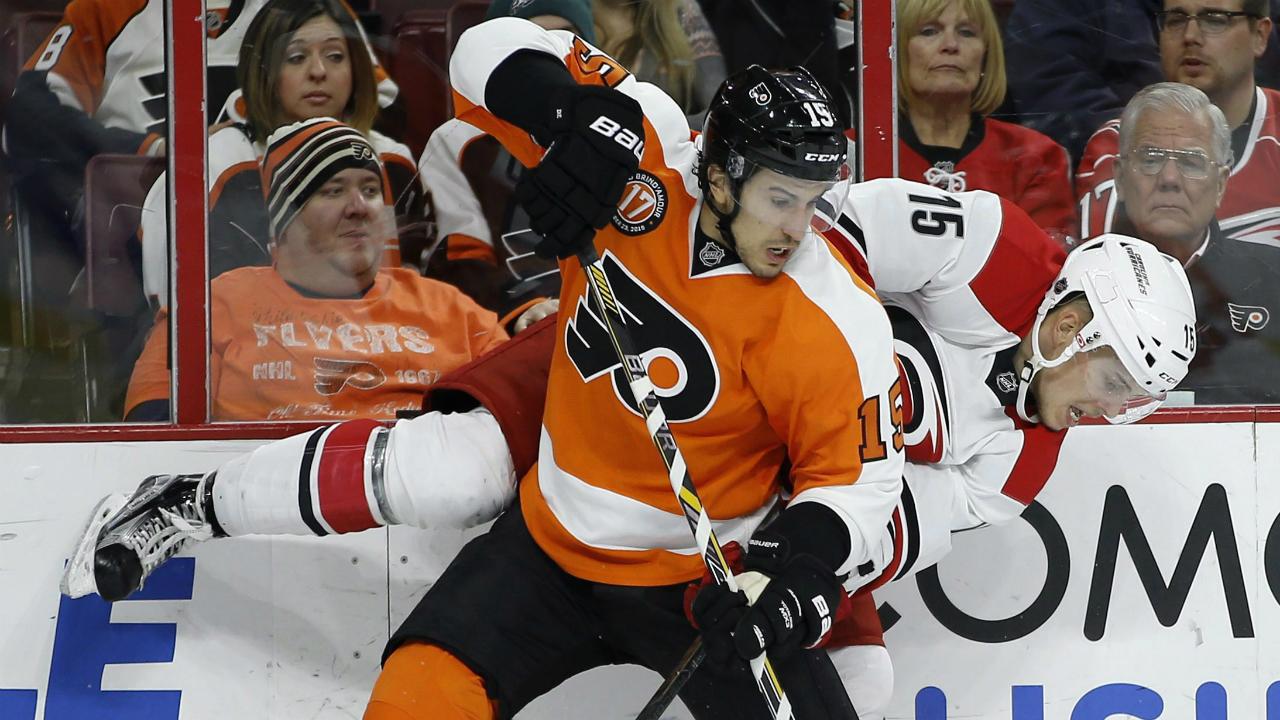Philadelphia-Flyers'-Michael-Del-Zotto,-left,-collides-with-Carolina-Hurricanes'-Andrej-Nestrasil-during-the-first-period-of-an-NHL-hockey-game,-Monday,-Nov.-23,-2015,-in-Philadelphia.-(AP-Photo/Matt-Slocum)