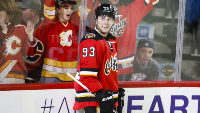 Calgary-Flames'-Sam-Bennett-celebrate-his-fourth-goal-during-third-period-NHL-hockey-action-against-the-Florida-Panthers-in-Calgary,-Wednesday,-Jan.-13,-2016.-As-with-any-rookie,-Bennett's-first-full-season-in-the-NHL-has-been-a-series-of-firsts---first-scoring-slump,-first-hat-trick,-first-four-goal-game-and-now-facing-the-team-he-grew-following-for-the-first-time.THE-CANADIAN-PRESS/Jeff-McIntosh