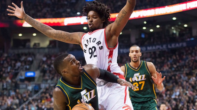Toronto-Raptors-centre-Lucas-Nogueira-(92)-defends-against-Utah-Jazz-guard-Shelvin-Mack-(Nathan-Denette/CP)
