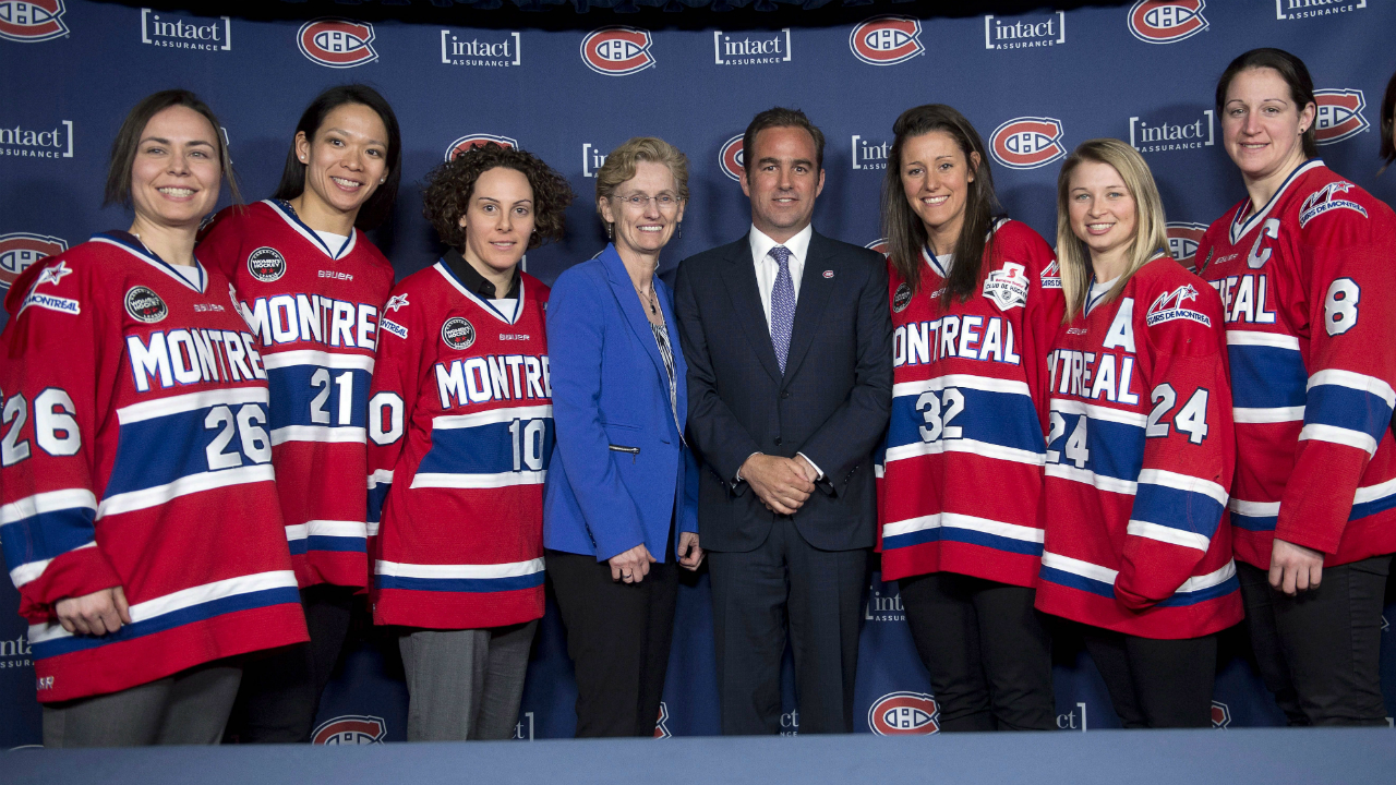 Montreal-Canadiens-chief-executive-Geoff-Molson-and-Canadian-Women's-Hockey-League-Comissioner-Brenda-Andress-pose-with-Montreal-Stars-players,-from-left,-Lisa-Marie-Breton-Lebreux,-Julie-Chu,-Noemie-Marin,-Charline-Labonte,-Ann-Sophie-Bettez,-and-Cathy-Chartrand,-right,-during-a-press-conference-in-Montreal.