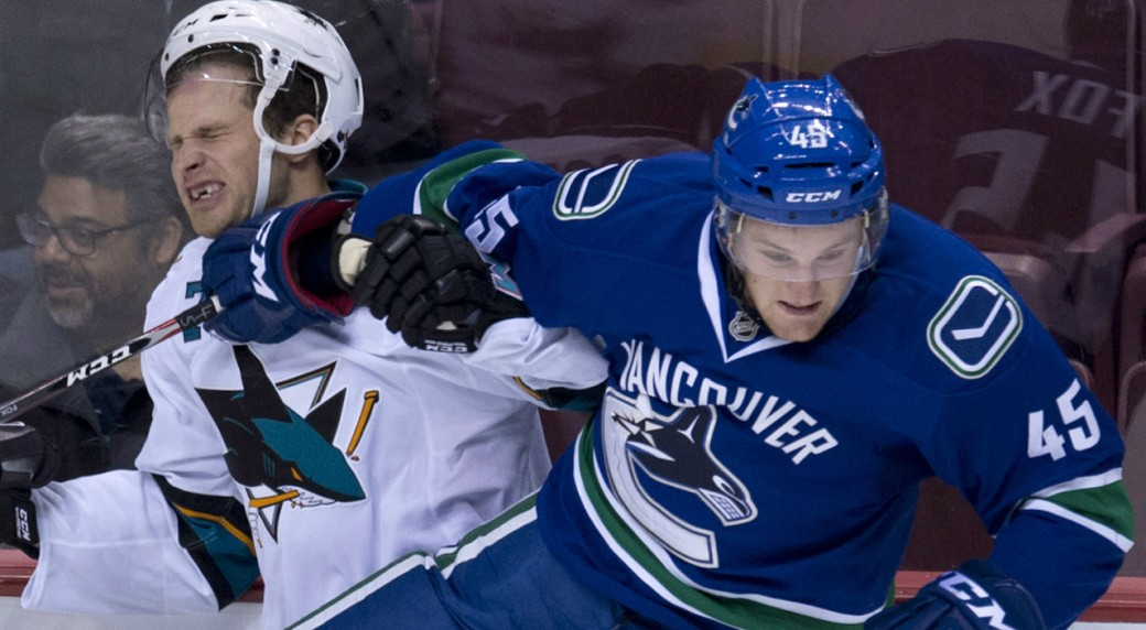 Vancouver-Canucks-Dane-Fox,-right,-puts-San-Jose-Sharks-center-Rylan-Schwartz-(72)-into-the-boards-during-the-first-period-of-NHL-pre-season-action-in-Vancouver,-B.C.-Tuesday,-Sept.-23,-2014.-THE-CANADIAN-PRESS/Jonathan-Hayward