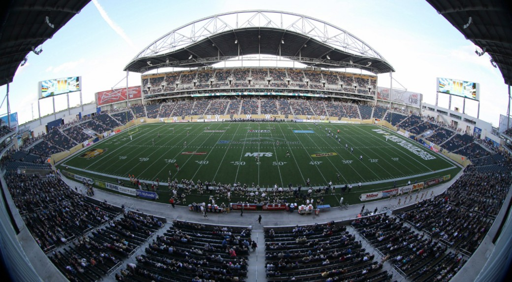 The-Toronto-Argonauts'-kick-the-ball-off-to-the-Winnipeg-Blue-Bombers'-to-open-the-first-pre-season-CFL-football-game-at-Investors-Group-Field-in-Winnipeg,-Wednesday,-June-12,-2013.-The-new-stadium-hosts-the-Bombers-and-the-University-of-Manitoba-Bisons.-THE-CANADIAN-PRESS/Trevor-Hagan