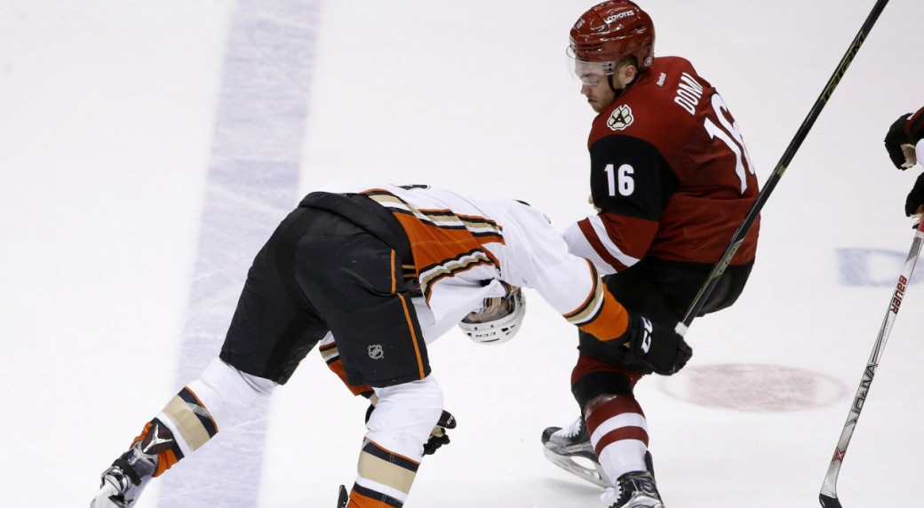 Arizona-Coyotes'-Max-Domi-(16)-pulls-down-Anaheim-Ducks'-Ryan-Garbutt,-left,-as-the-two-fight-during-the-third-period-of-an-NHL-hockey-game-Thursday,-March-3,-2016,-in-Glendale,-Ariz.-The-Ducks-defeated-the-Coyotes-5-1.-(AP-Photo/Ross-D.-Franklin)