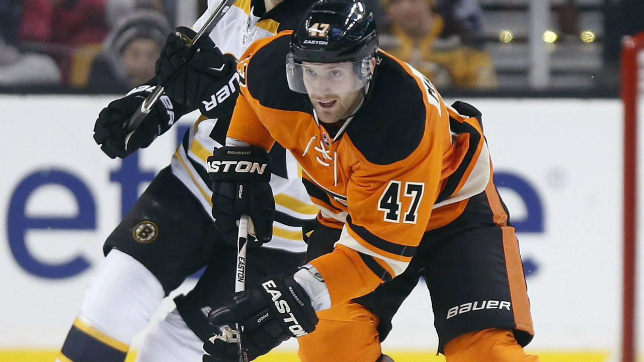 Philadelphia-Flyers'-Andrew-MacDonald-(47)-brings-the-puck-up-in-front-of-Boston-Bruins'-Carl-Soderberg-(34),-of-Sweden,-during-the-first-period-of-an-an-NHL-hockey-game-in-Boston,-Saturday,-March-7,-2015.-(AP-Photo/Michael-Dwyer)