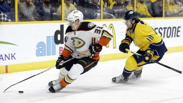 Anaheim-Ducks-right-wing-Jakob-Silfverberg-(33),-of-Sweden,-chases-the-puck-with-Nashville-Predators-left-wing-James-Neal-(18)-during-the-first-period-of-Game-4-in-an-NHL-hockey-first-round-Stanley-Cup-playoff-series-Thursday,-April-21,-2016,-in-Nashville,-Tenn.-(AP-Photo/Mark-Humphrey)