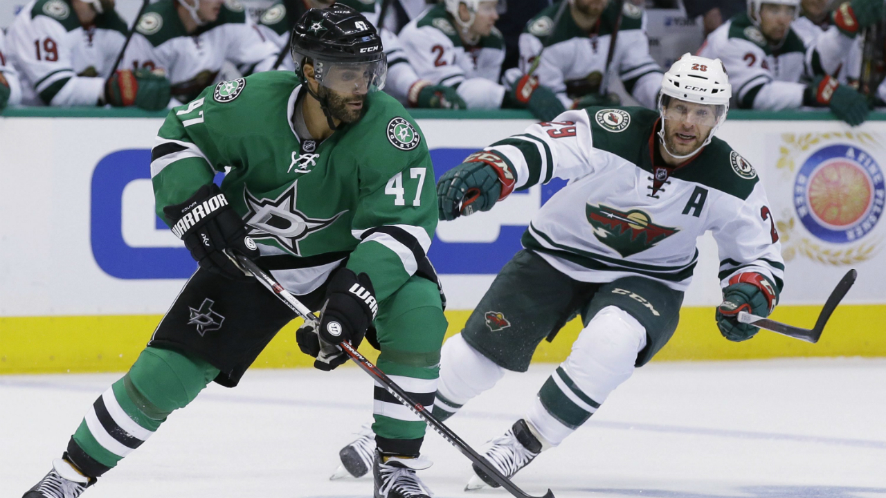 Dallas-Stars-defenseman-Johnny-Oduya-(47)-skates-with-the-puck-against-Minnesota-Wild-right-wing-Jason-Pominville-(29)-during-the-second-period-of-Game-1-in-a-first-round-NHL-hockey-Stanley-Cup-playoff-series-Thursday,-April-14,-2016,-in-Dallas.-(AP-Photo/LM-Otero)