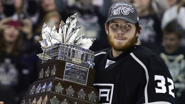 Los-Angeles-Kings-goalie-Jonathan-Quick-carries-the-Conn-Smythe-trophy-as-the-most-valuable-player-after-the-Kings-beat-the-New-Jersey-Devils-6-1-to-win-the-Stanley-Cup-during-Game-6-of-the-NHL-hockey-Stanley-Cup-finals,-Monday,-June-11,-2012,-in-Los-Angeles.-(AP-Photo/Mark-J.-Terrill)