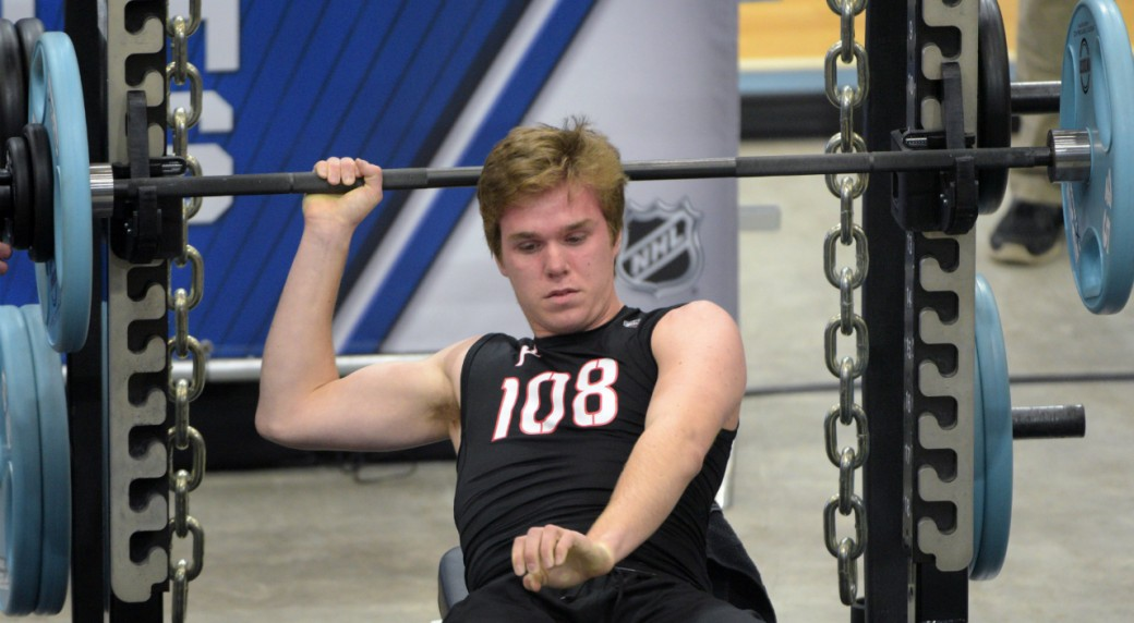 Connor-McDavid-finishes-his-bench-press-during-the-NHL-Combine-Saturday,-June-6,-2015,-in-Buffalo,-N.Y.-(AP-Photo/Gary-Wiepert)