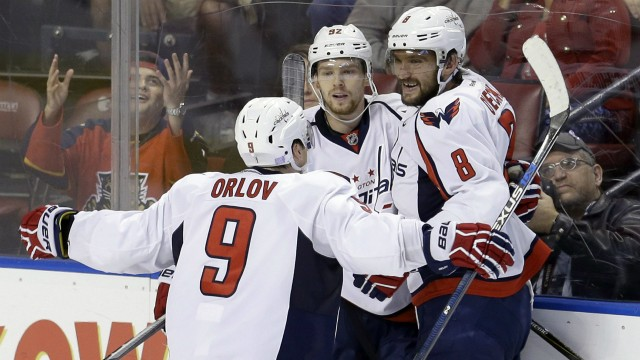 Washington-Capitals-defenseman-Dmitry-Orlov-(9)-and-Alex-Ovechkin-(8)-congratulate-Evgeny-Kuznetsov-(92)-after-Kuznetsov-scored-the-game-winning,-2-1,-goal-against-the-Florida-Panthers-in-overtime-of-an-NHL-hockey-game,-Saturday,-Oct.-31,-2015,-in-Sunrise,-Fla.-(AP-Photo/Alan-Diaz)