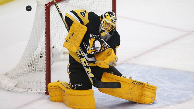 Pittsburgh-Penguins-goalie-Marc-Andre-Fleury-(29)-blocks-a-shot-during-the-first-period-of-an-NHL-hockey-game-against-the-New-York-Rangers-in-Pittsburgh,-Thursday,-March-3,-2016.-(AP-Photo/Gene-J.-Puskar)