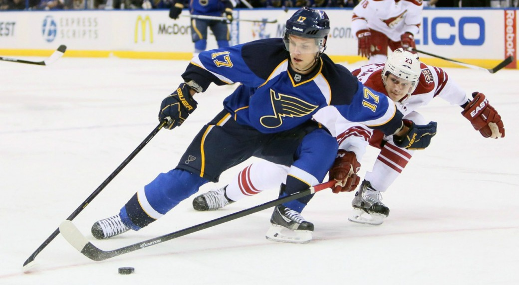 St.-Louis-Blues-left-wing-Vladimir-Sobotka,-left,-tries-to-keep-possession-of-the-puck-against-Phoenix-Coyotes-defenseman-Oliver-Ekman-Larsson-in-the-first-period-of-an-NHL-hockey-game-Tuesday,-Nov.-12,-2013,-in-St.-Louis.-(AP-Photo/St.-Louis-Post-Dispatch,-Chris-Lee)