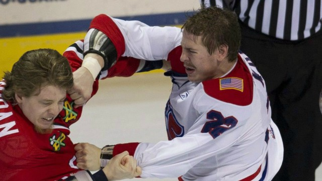 Portland-Winterhawks'-Tayler-Jordan,-left,-and-Spokane-Chiefs'-Darren-Kramer-fight-during-the-third-period-of-game-4-of-WHL-Western-Conference-hockey-finals-in-Spokane,-Wash.,-on-Friday,-April-29,-2011.-Kramer,-a-forward-with-the-Manitoba-Moose-of-the-American-Hockey-League,-was-arrested-on-Tuesday-after-a-confrontation-at-Disney-World-in-Florida.Darren-Kramer's-agent-says-the-player-was-taken-in-on-suspicion-of-grand-theft,-resisting-arrest-and-battery-of-a-law-enforcement-officer.-THE-CANADIAN-PRESS/AP/The-Spokesman-Review,-Colin-Mulvany-COEUR-D'ALENE-PRESS-OUT
