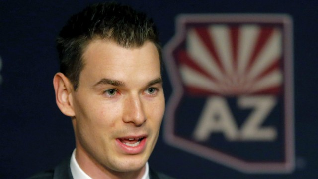Newly-appointed-Arizona-Coyotes-general-manager-John-Chayka-speaks-at-a-news-conference-announcing-his-promotion,-Thursday,-May-5,-2016,-in-Glendale,-Ariz.-Chayka-is-the-youngest-GM-in-NHL-history.-(AP-Photo/Matt-York)