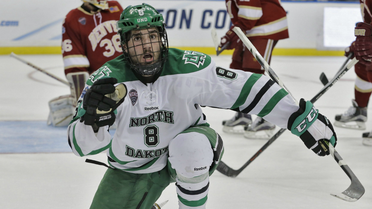 North-Dakota-forward-Nick-Schmaltz-(8)-reacts-after-scoring-against-Denver-during-final-seconds-of-an-NCAA-Frozen-Four-men's-college-hockey-semifinal,-Thursday,-April-7,-2016,-in-Tampa,-Fla.-(AP-Photo/Chris-O'Meara)