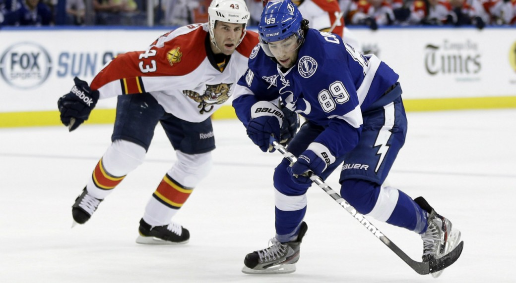 Tampa-Bay-Lightning-left-wing-Cory-Conacher-(89)-gets-past-Florida-Panthers-defenseman-Mike-Weaver-(43)-during-the-second-period-of-an-NHL-hockey-game-Tuesday,-Jan.-29,-2013,-in-Tampa,-Fla.-Conacher-was-called-for-holding-on-the-play.-(AP-Photo/Chris-O'Meara)
