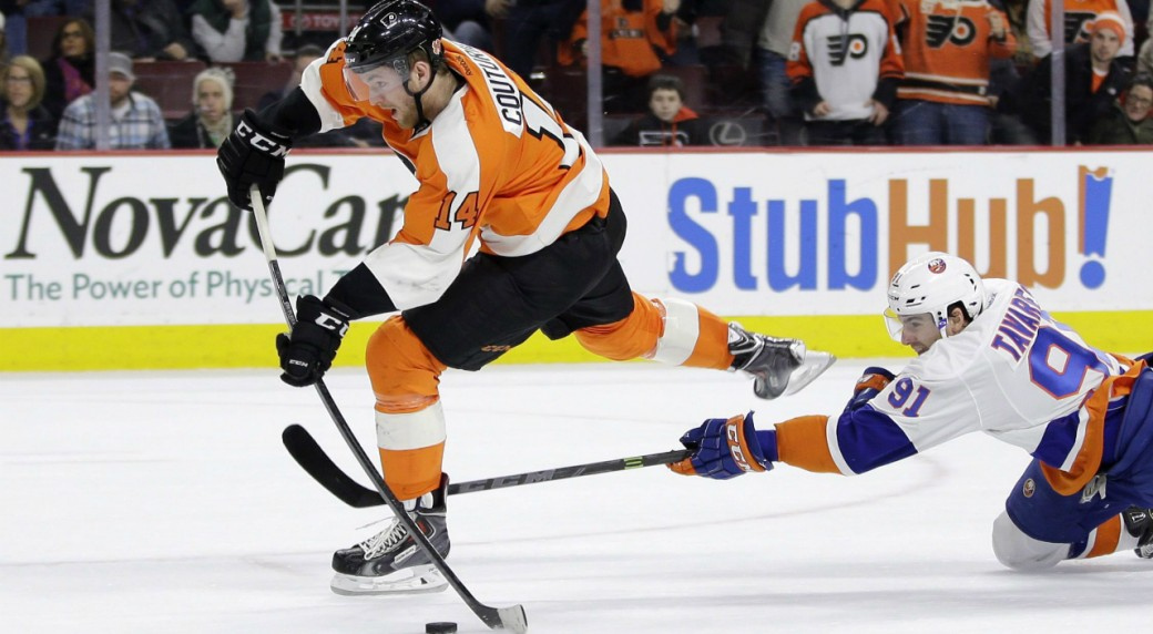 Philadelphia-Flyers'-Sean-Couturier,-left,-tries-to-get-a-shot-off-as-New-York-Islanders'-John-Tavares-defends-during-overtime-of-an-NHL-hockey-game,-Thursday,-Feb.-5,-2015,-in-Philadelphia.-New-York-won-3-2-in-a-shootout.-(AP-Photo/Matt-Slocum)