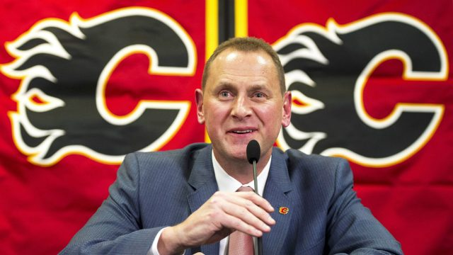 Calgary-Flames'-new-GM-Brad-Treliving-speaks-at-a-press-conference-after-being-introduced-in-Calgary,-Alta.,-on