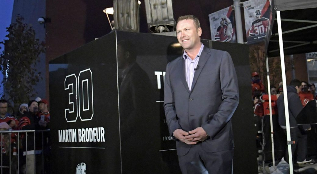 Former-New-Jersey-Devils-goaltender-Martin-Brodeur-poses-in-front-of-his-statue-which-was-unveiled-outside-the-Prudential-Center-before-the-Devils'-NHL-hockey-game-against-the-Minnesota-Wild,-Saturday,-Oct.-22,-2016,-in-Newark,-N.J.-(AP-Photo/Bill-Kostroun)