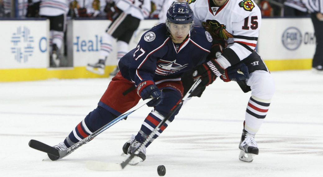Columbus-Blue-Jackets'-Ryan-Murray,-left,-tries-to-move-the-puck-past-Chicago-Blackhawks'-Artem-Anisimov,-of-Russia,-during-the-first-period-of-an-NHL-hockey-game-Friday,-Oct.-21,-2016,-in-Columbus,-Ohio.-(AP-Photo/Jay-LaPrete)