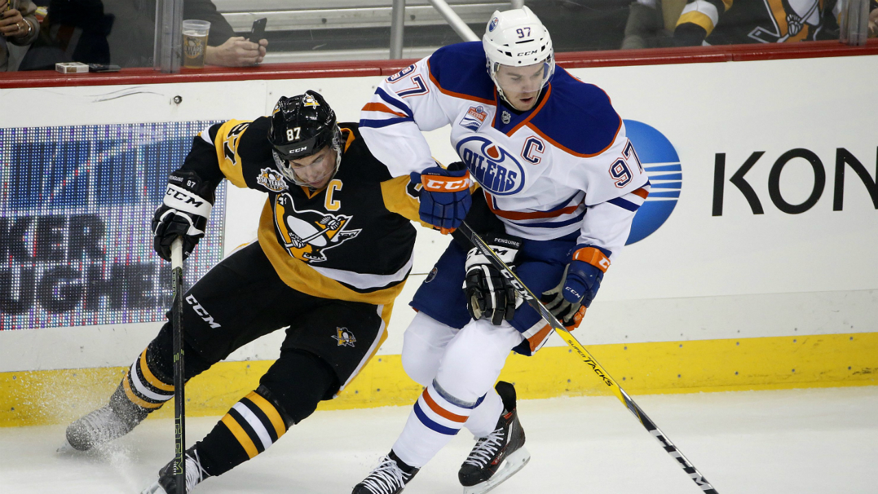 Edmonton-Oilers'-Connor-McDavid-(97)-and-Pittsburgh-Penguins'-Sidney-Crosby-(87)-compete-for-the-puck-during-the-first-period-of-an-NHL-hockey-game-in-Pittsburgh,-Tuesday,-Nov.-8,-2016.-(AP-Photo/Gene-J.-Puskar)