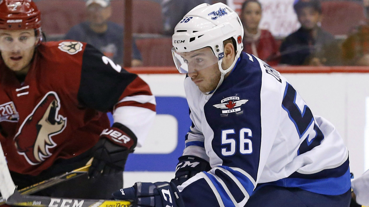Winnipeg-Jets-centre-Marko-Dano-(56)-tries-to-get-control-of-the-puck-in-front-of-Arizona-Coyotes-defenceman-Luke-Schenn-(2)-during-the-first-period-of-an-NHL-hockey-game-Thursday,-Nov.-10,-2016,-in-Glendale,-Ariz.-(Ross-D.-Franklin/AP)