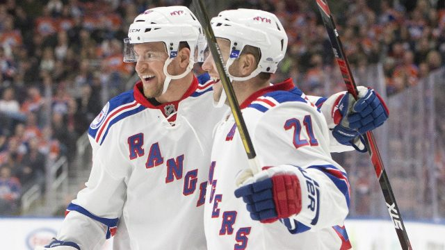 New-York-Rangers'-Michael-Grabner-(40)-and-Derek-Stepan-(21)-celebrate-a-goal-against-the-Edmonton-Oilers'during-first-period-NHL-action-in-Edmonton,-Alta.,-on-Sunday-November-13,-2016.-(Jason-Franson/CP)
