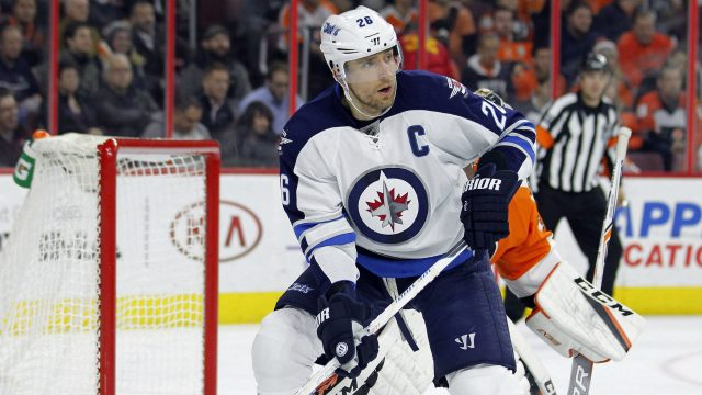 Winnipeg-Jets'-Blake-Wheeler-stands-in-front-of-Philadelphia-Flyers-goalie-Steve-Mason-as-he-waits-for-a-pass-during-the-first-period-of-an-NHL-hockey-game,-Thursday,-Nov.-17,-2016,-in-Philadelphia.-(Tom-Mihalek/AP)