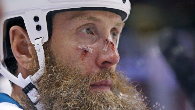 San-Jose-Sharks'-Joe-Thornton-sits-on-the-bench-after-getting-hit-with-a-stick-during-the-third-period-of-an-NHL-preseason-hockey-game-against-Arizona-Coyotes-on-Friday,-Oct.-7,-2016,-in-Glendale,-Ariz.-The-Coyotes-defeated-the-Sharks-3-1.-(Ross-D.-Franklin/AP)