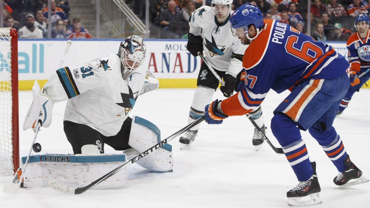 San-Jose-Sharks'-goalie-Martin-Jones-(31)-makes-a-save-on-Edmonton-Oilers'-Benoit-Pouliot-(67)-during-second-period-NHL-action-in-Edmonton,-Alta.,-on-Tuesday-January-10,-2017.-(Jason-Franson/CP)