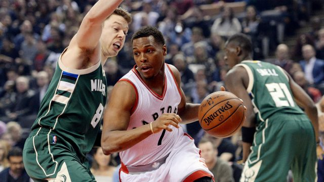 Milwaukee-Bucks-guard-Matthew-Dellavedova-(8)-guards-Toronto-Raptors-guard-Kyle-Lowry-(7)-as-he-drives-to-the-net-during-first-half-NBA-basketball-action-in-Toronto-on-Friday,-January-27,-2017.-(Nathan-Denette/CP)