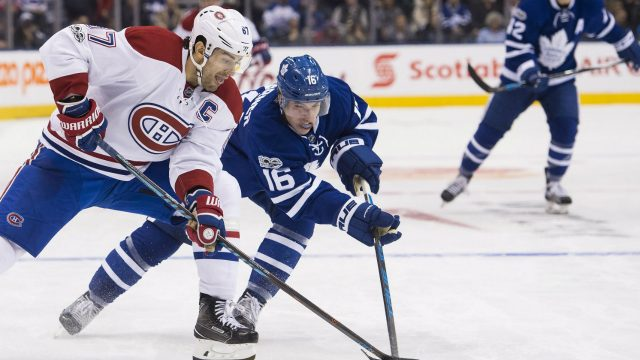 Montreal-Canadiens-left-wing-Max-Pacioretty-(67)-vies-for-the-puck-with-Toronto-Maple-Leafs-centre-Mitchell-Marner-(16)-during-third-period-NHL-hockey-action-in-Toronto-on-Saturday,-January-7,-2017.-(Nathan-Denette/CP)