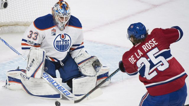 Montreal-Canadiens'-Jacob-De-La-Rose-takes-a-shot-on-Edmonton-Oilers-goaltender-Cam-Talbot-during-first-period-NHL-hockey-action-in-Montreal,-Sunday,-February-5,-2017.-(Graham-Hughes/CP)