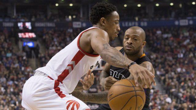Toronto-Raptors'-DeMar-DeRozan-(left)-drives-past-Phoenix-Suns'-P.J.-Tucker-during-first-half-NBA-basketball-action-in-Toronto-on-Sunday,-January-22,-2017.-(Chris-Young/CP)