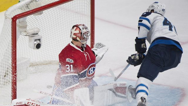 Montreal-Canadiens-goaltender-Carey-Price-is-scored-on-by-Winnipeg-Jets'-Joel-Armia-during-second-period-NHL-hockey-action-in-Montreal,-Saturday,-February-18,-2017.-(Graham-Hughes/CP)