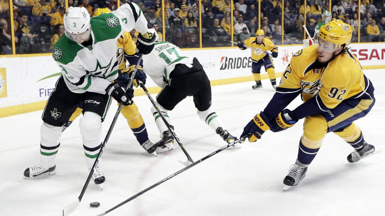 Dallas-Stars-defenceman-John-Klingberg-(3),-of-Sweden,-and-Nashville-Predators-centre-Ryan-Johansen-(92)-fight-for-the-puck-during-the-second-period-of-an-NHL-hockey-game-Sunday,-Feb.-12,-2017,-in-Nashville,-Tenn.-(Mark-Humphrey/AP)