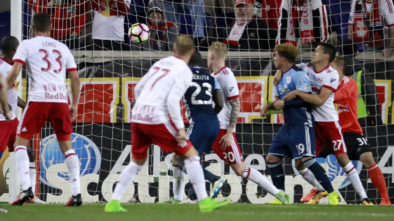 A-shot-by-Vancouver-Whitecaps-forward-Kekuta-Manneh-(23)-enters-the-net-of-New-York-Red-Bulls-goalkeeper-Luis-Robles-(31)-for-a-goal-during-the-first-half-of-a-CONCACAF-Champions-League-quarterfinal-soccer-match,-Wednesday,-Feb.-22,-2017,-in-Harrison,-N.J.-(Julio-Cortez/AP)