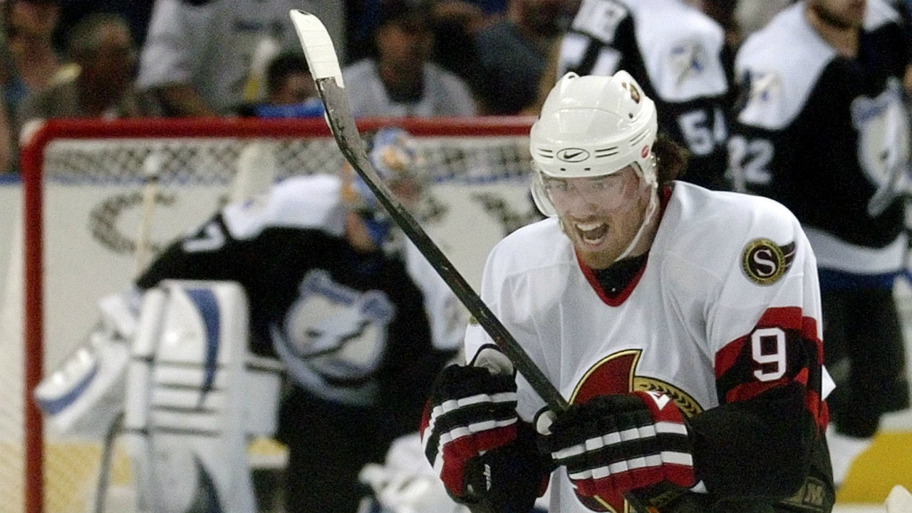 Ottawa-Senators-right-wing-Martin-Havlat-(9),-of-the-Czech-Republic,-celebrates-his-goal-past-Tampa-Bay-Lightning's-John-Grahame,-left,-during-the-second-period-of-their-NHL-playoff-hockey-game-Thursday,-April-27,-2006-in-Tampa,-Fla.-(Steve-Nesius/AP)