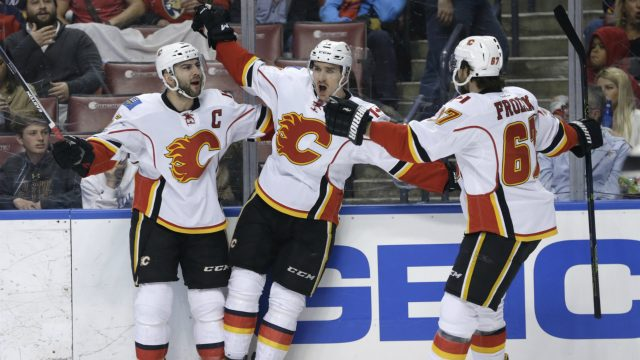 Calgary-Flames-centre-Mikael-Backlund,-centre,-celebrates-with-right-wing-Michael-Frolik-(67)-after-scoring-a-goal-during-the-first-period-of-an-NHL-hockey-game-against-the-Florida-Panthers,-Friday,-Feb.-24,-2017,-in-Sunrise,-Fla.-(Lynne-Sladky/AP)