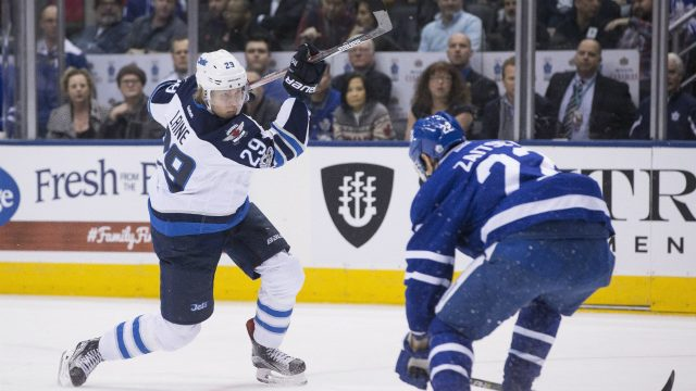 Winnipeg-Jets-right-wing-Patrik-Laine-(left)-scores-his-team's-opening-goal-as-Toronto-Maple-Leafs-defenceman-Nikita-Zaitsev-covers-during-first-period-NHL-hockey-action,-in-Toronto-on-Tuesday,-February-21,-2017.-(Chris-Young/CP)