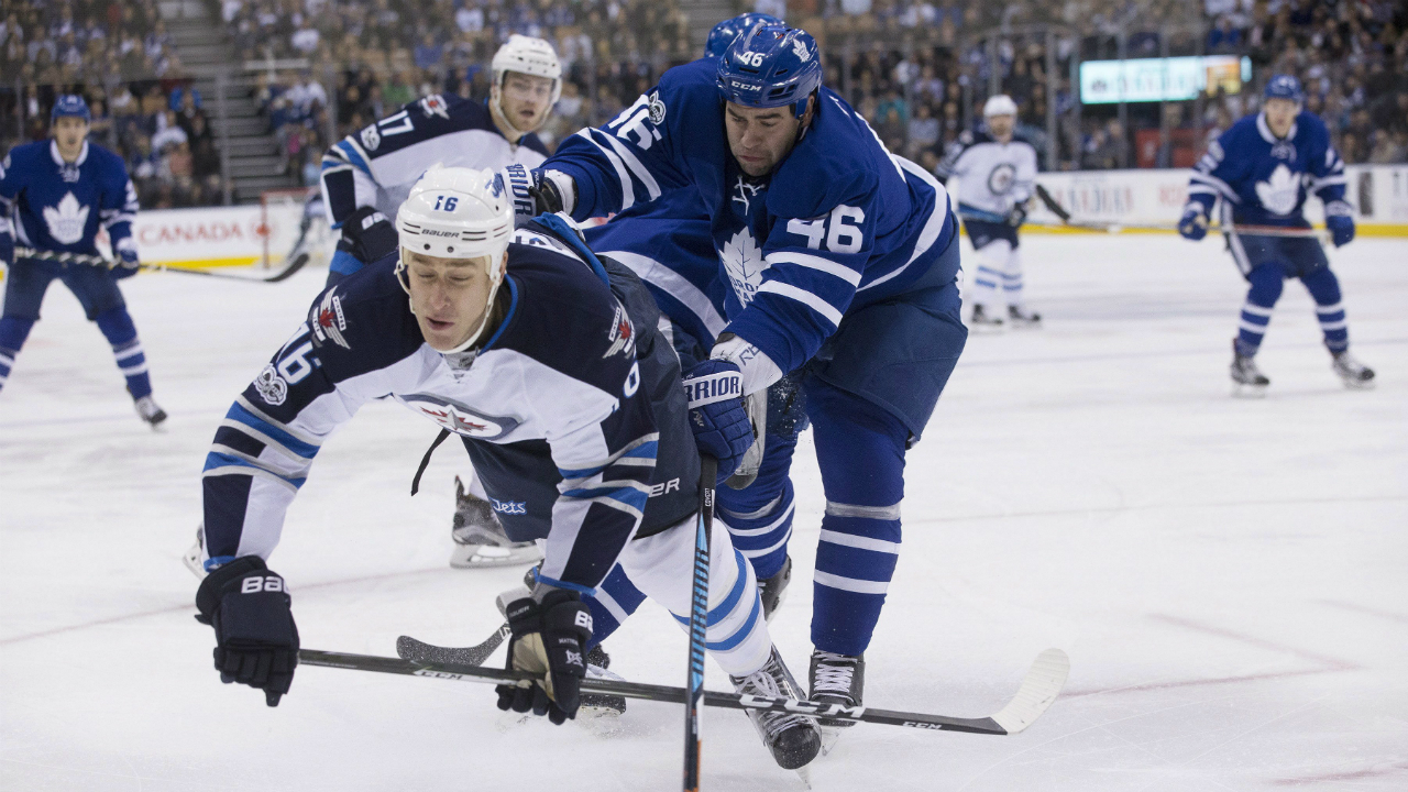 Winnipeg-Jets-left-wing-Shawn-Matthias-(16)-gets-pushed-off-the-puck-by-Toronto-Maple-Leafs-defenceman-Roman-Polak-(46)-during-first-period-NHL-hockey-action,-in-Toronto-on-Tuesday,-February-21,-2017.-(Chris-Young/CP)