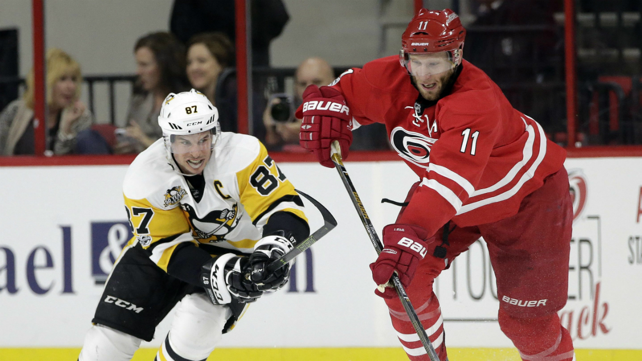 Pittsburgh-Penguins'-Sidney-Crosby-(87)-and-Carolina-Hurricanes'-Jordan-Staal-(11)-chase-the-puck-during-the-second-period-of-an-NHL-hockey-game-in-Raleigh,-N.C.,-Tuesday,-Feb.-21,-2017.-(Gerry-Broome/AP)
