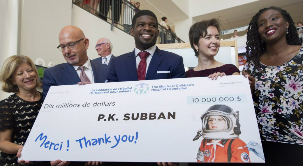 Montreal-Canadiens-defenceman-P.K.-Subban,-centre,-smiles-as-he-poses-for-the-cameras-following-a-press-conference-at-the-Children's-Hospital-in-Montreal,-Wednesday,-September-16,-2015,-where-he-announced-that-his-foundation-would-pledge-$10-million-to-the-hospital.-(Graham-Hughes/CP)